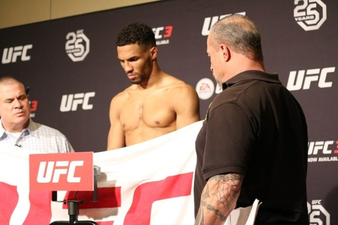 Kevin Lee weighs in, behind a towel, ahead of UFC Atlantic City