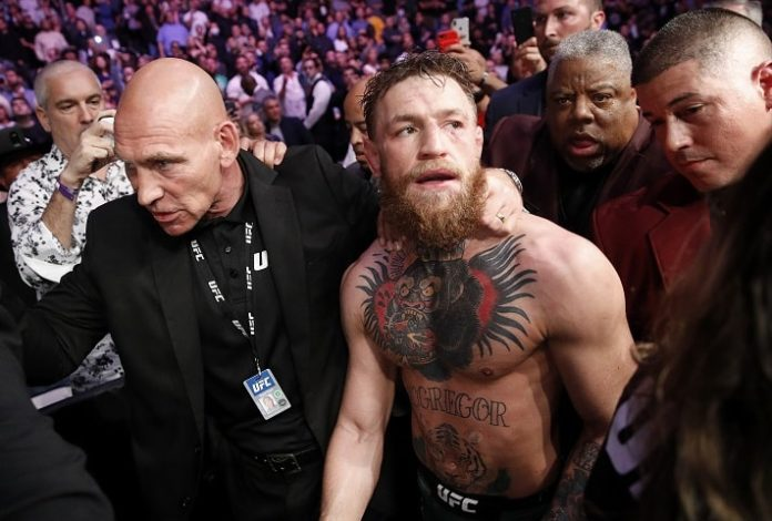 Conor McGregor exiting the cage following UFC 229