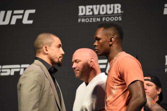 Whittaker Adesanya Face Off UFC 243