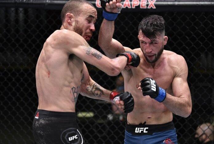 Julian Erosa punches Sean Woodson UFC on ESPN 12