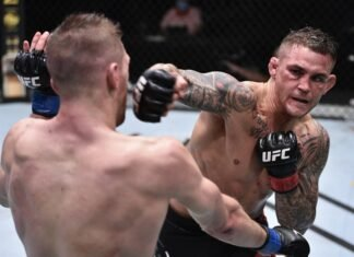 Dustin Poirier punches Dan Hooker at UFC on ESPN 12