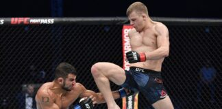 Grant Dawson (right) launches a flying knee at Nad Narimani, UFC Fight Island 2