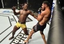 Abdul Razak Alhassan of Ghana punches Mounir Lazzez UFC Fight Island 1
