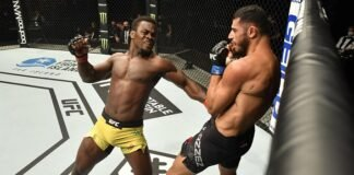 Abdul Razak Alhassan of Ghana punches Mounir Lazzez UFC Fight Island 1