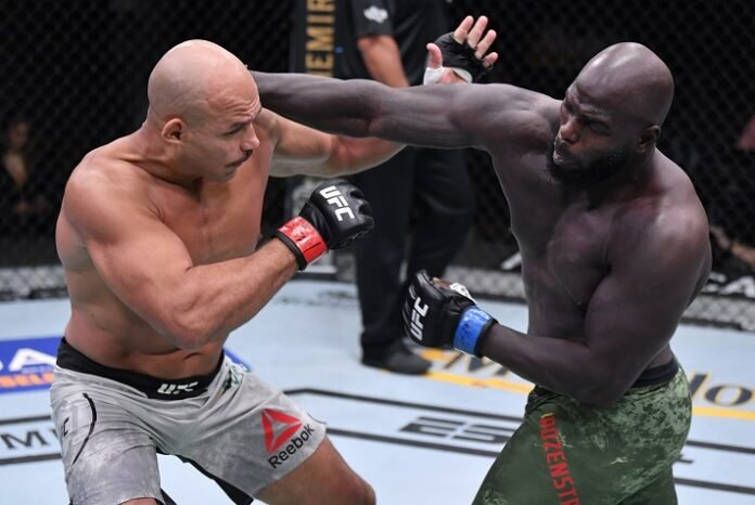 Jairzinho Rozenstruik of Suriname punches Junior Dos Santos at UFC 252