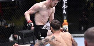 Cory Sandhagen hits Franke Edgar with a flying knee at UFC Vegas 18