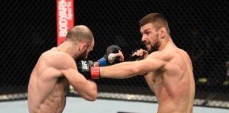 Mateusz Gamrot of Poland punches Guram Kutateladze, UFC
